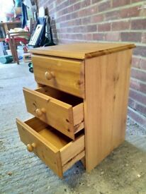 Two pine bedside tables with three draws