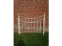 Cream metal bed frame and mattress