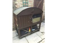 Big wooden rabbit hutch with two levels and a removable roof. Needs some fixing up! FREE!