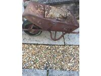 Old, rusted, metal wheelbarrow available for FREE. Ideal for flowerbed, garden decor etc