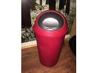 Red plastic roll top kitchen bin