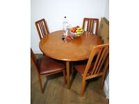 extendable dinning table with 4 chairs in good condition