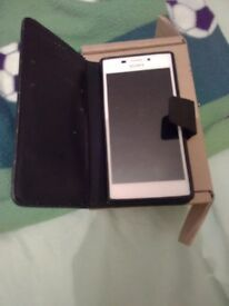Sony experia m2 nearly new on o2 with case and charger