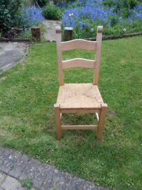 4 identical wooden dining room chairs