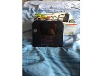 Nintendo 2ds with mario kart 7 and super mario maker