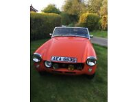 1978 mg midget 1500,great little sports car in vermillion,with 77000 genuine miles.Offers over 2300.