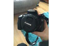 Canon DSLR 1100d - camera, camera bag, 18-55mm lens, 50mm lens, charger, camera bag