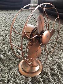 Quirky decorative metal fan