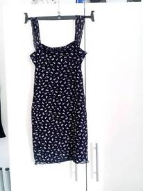 Black flowered double layered figure hugging dress. £7