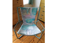 Blue metal chair with cushions