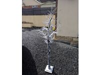 Small artificial winter christmas tree