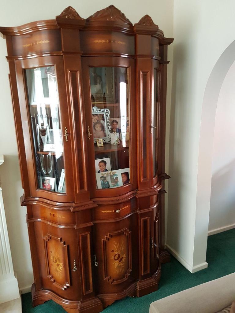 Dark brown oak display cabinet