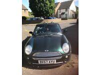 British racing green mini convertible
