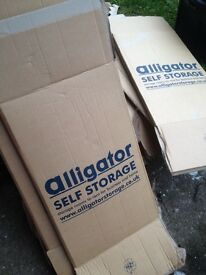 8 large packing or storage cardboard boxes