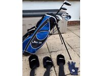 Left handed set of Junior Jaxx golf clubs with bag