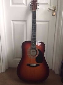 Falcon acoustic guitar + case, tuner, capo, picks, strap + another classical guitar for FREE