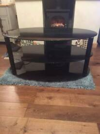 **Glass oval TV stand**