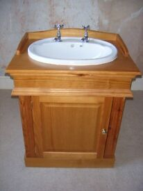 Ceramic basin with pine cupboard