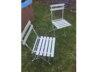 Two green garden chairs