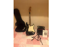Squier by Fender Strat Electric Guitar - Black with amp, stand