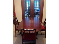 Stag Minstrel Dining Room Table and 4 Chairs (2 are Carvers)