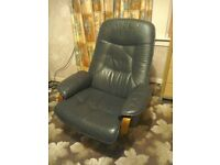 Chair. Reclining swivel chair and foot stool. Faux leather. Very good condition