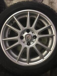185/55/15 Continental XtremWinter  8-10/32 + mags 15 pouces DAI.   5x98.  Fiat