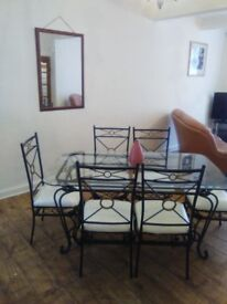 Glass table, 6 chairs, coffee table and lamp table