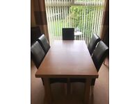 Wood and leather extendable dining table with 6 chairs.