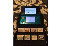 Nintendo 3DS with 9 games, including Mario 3D land, Mario Party, Disney Infinity, Zelda DS