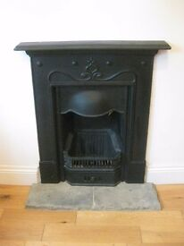 Black cast iron fireplace. 'The Tulip' reproduction Art Nouveau style. Excellent condition.