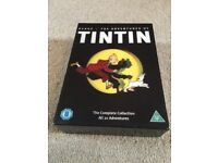 """Tintin 2011 DVD boxed set. """"The complete 21 adventures!"""" Fully remastered on 5 discs"""