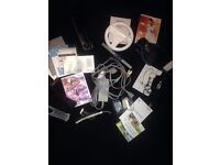 Nintendo Wii Black Console + 3 Games + 2 Controllers & Charging Station, 2 Nunchucks & Wii Wheel