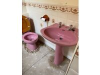 Retro pink sink toilet and shower tray.