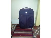 2 dark brown Tripp suitcases 68cmx43cmx28cm £10 each