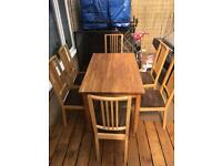 Dining table with 6 chairs in good condition ikea