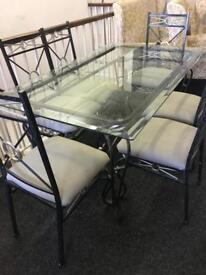 Glass dining table and chairs can deliver