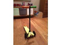 Yellow micro mini scooter