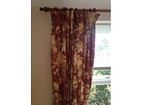 Full length curtains.Two pairs of full length red and flower patterned curtains.