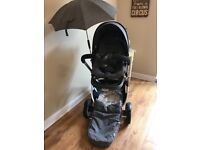 Stokke black Melange CRUSI footmuff raincover travel pack