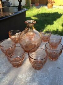 Small pink vintage decanter and eight glasses