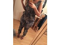 River Island Jumpsuit/ front zip/ leopard front / black back size 14