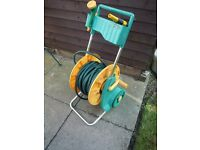 Garden hosepipe on stand to wind up with spray attachments