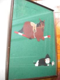 A HORSE JUMPING CARTOON PICTURE IN FELT FRAMED 24X16 INCHES