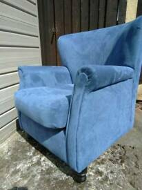 Spoonback chair in hard wearing fabric.