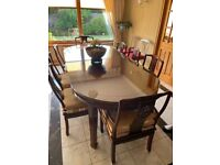 Chinese rosewood dining table,chairs and protective glass top together with matching breakfront