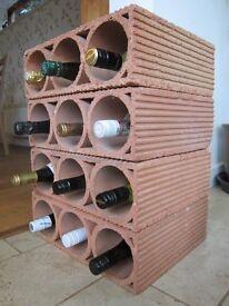 Terracotta Wine Rack. Stacks flat or upright 3 bottles per module.
