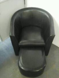 Black tub chair with integral footstool