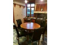 Round oak table and six chairs