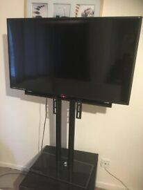 technika 40 inch TV with adjustable stand